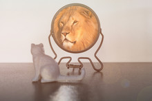 Kitten Looks In The Mirror And Sees Himself Reflected Like A Lion. Self-confidence Concept. Business Or Personal Growth.