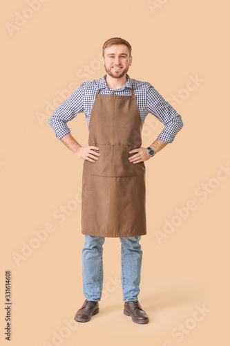 Fototapeta Handsome male bartender on color background