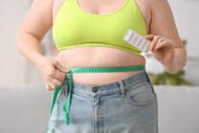 Woman With Weight Loss Pills A...