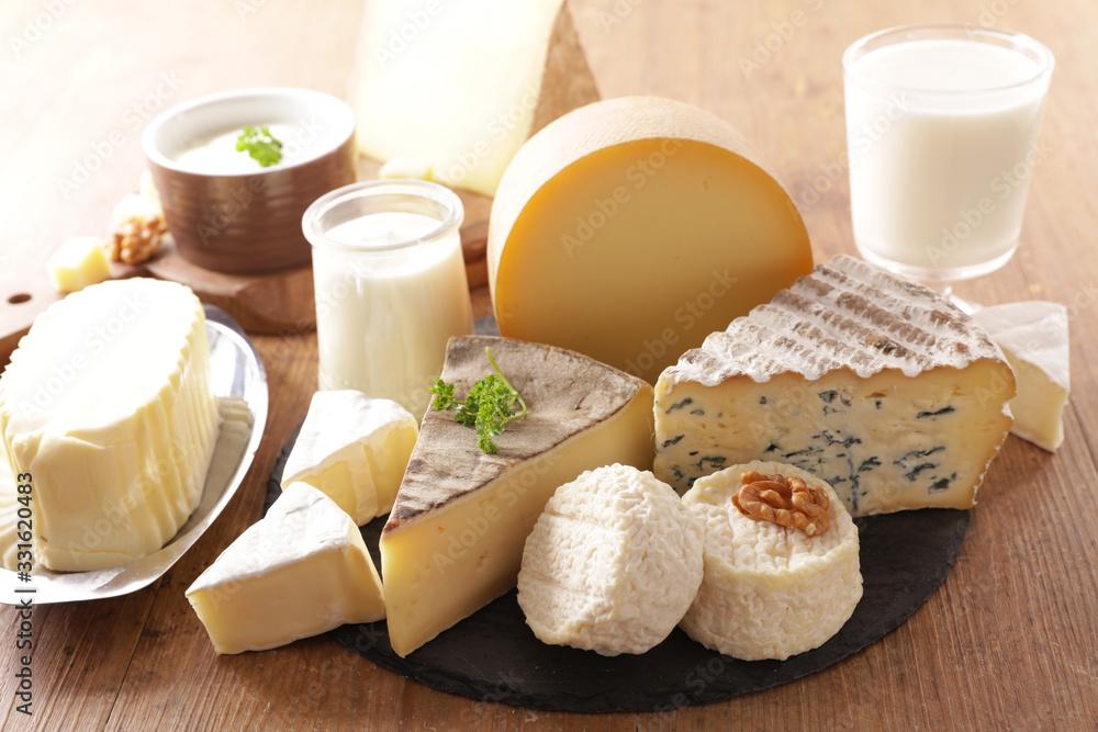 Fototapeta assorted of dairy product- cheese, milk, butter, yogurt