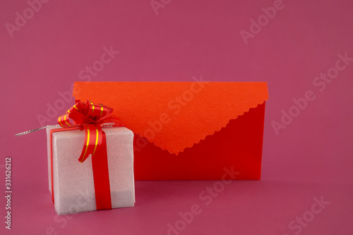 Romantic still life with gift and envelope