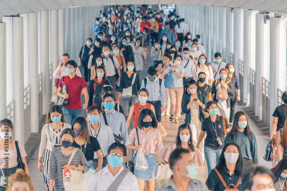 Fototapeta Bangkok City, Thailand : 03/12/2020 : Unidentified people, Crowd of Thai wearing face mask for health due to Coronavirus Disease or covid-19 and  air pollution in mass transit in public. Rush hour.
