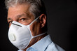 man wearing a professional ffp2 mask against virus