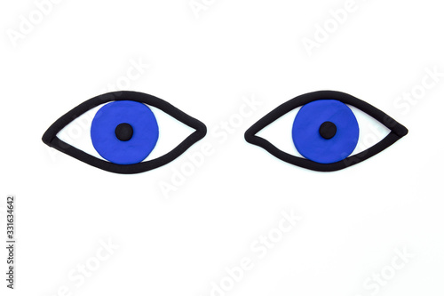 Photo Pair of waching blue eyes on white background