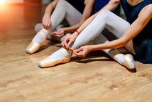 Young Ballet Dancers Tying Sli...