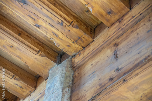 Photo Architectonic detail, wooden log room corner, decor motif