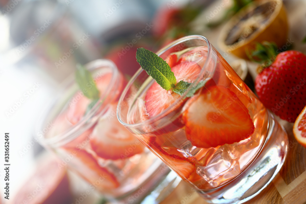 Fototapeta Strawberry punch home made cocktail closeup on wood background