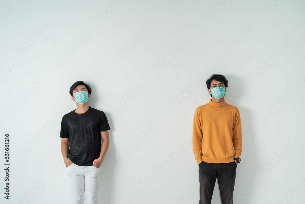 Fototapeta social distancing. people with masks keep their distance during virus symptoms