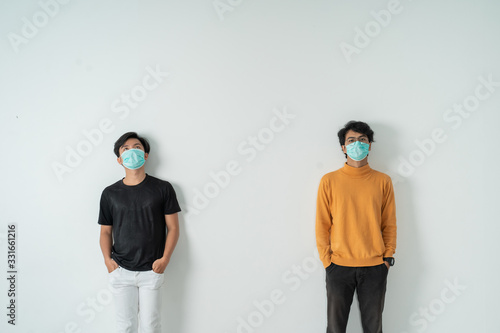 Obraz social distancing. people with masks keep their distance during virus symptoms - fototapety do salonu