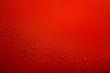 Leinwandbild Motiv Water drops on red background