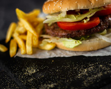 Tasty Burger With Tomatoes And Lettuce