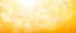 A blurred golden warm yellow and orange abstract sunny summer sky background Illustration.