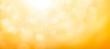 Leinwandbild Motiv A blurred golden warm yellow and orange abstract sunny summer sky background Illustration.