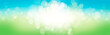 A blurred fresh spring, summer blue and green abstract banner background with bokeh glow.
