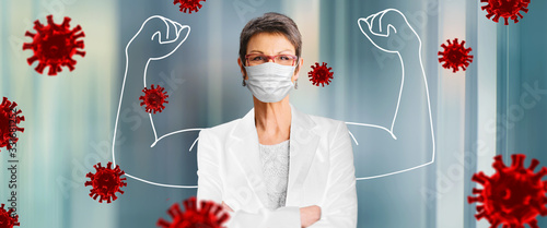 Obraz woman, doctor in medical face protection mask indoors on blue background - fototapety do salonu