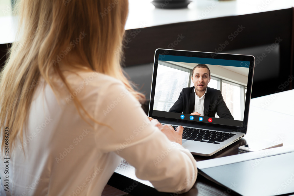 Fototapeta Businesswoman making video call to business partner using laptop, looking at screen with virtual web chat, contacting client by conference, talking on webcam, online consultation, hr concept, close up