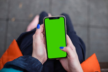 Woman Wearing Fashion Clothes In Dark Blue And Orange Holding IPhone11 IPhone XR Green Screen, Blue Nails