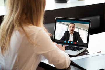 Fototapeta na wymiar Businesswoman making video call to business partner using laptop, looking at screen with virtual web chat, contacting client by conference, talking on webcam, online consultation, hr concept, close up