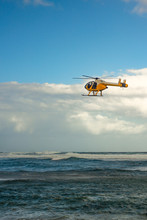 A Search And Rescue Helicopter Over Stormy Pacific Ocean