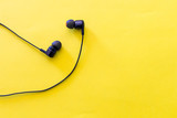 headphones for listening  music in relax moment lay on color background. background for relax and free days with music. smart activities and music streaming services