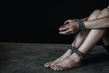 Human Trafficking Concept. Children With Chain Tied.Abused And Tortured Concept.