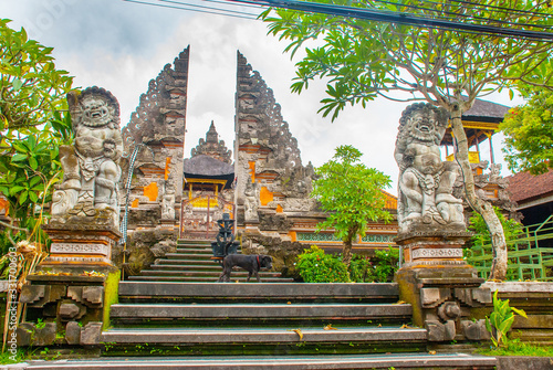 Fotografie, Obraz UBUD, BALI, INDONESIA - APRIL 2017: Beautiful Balinese entrance gate of the temple, a Pura Pusen temple in the center of Ubud, Bali, Indonesia
