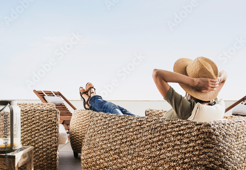 Obraz Young woman resting on terrace at home, Beautiful girl enjoying life, Vacations and summer fun concept - fototapety do salonu
