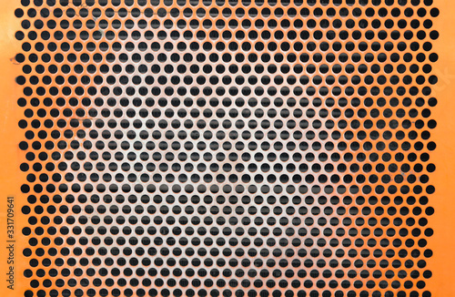 Vászonkép perforated metal grid many holes orange construction texture background