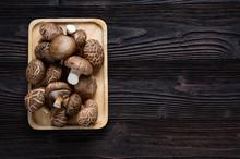 Shiitake Mushrooms On The Wood...