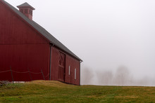 A Red Barn On A Foggy Morning ...