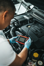 Close Up Shot Of Car Mechanic Using Laptop Computer For Error Tracing And Diagnostic.