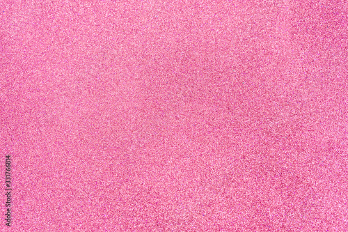 Hot pink glitter twinkle abstract New Year or Christmas holiday background with sparkles. Modern luxury mock up with sequins. Texture of colored porous rubber with spangles