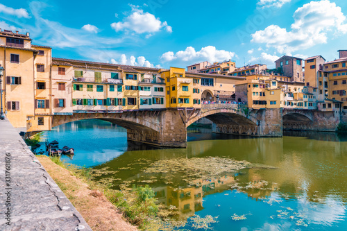 Ponte Vecchio bridge over the Arno River in Florence Italiy, colourful bridge ov Wallpaper Mural