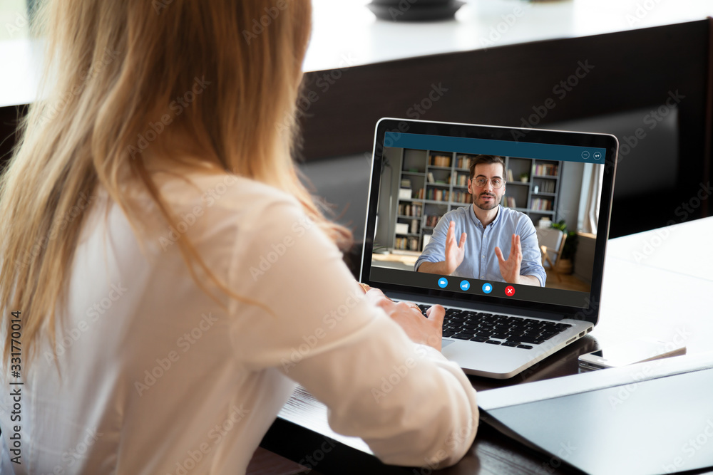 Fototapeta View over shoulder employer listen applicant at job interview online use cam and pc. To prevent spread corona virus covid19 infectious epidemia colleagues working distantly, self-isolation hr concept