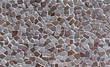 Detail einer industriell gefertigten, künstlichen Steinwand