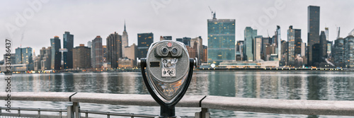 Panorama of tourist binoculars with Manhattan, New York City skyline in the back Fotobehang