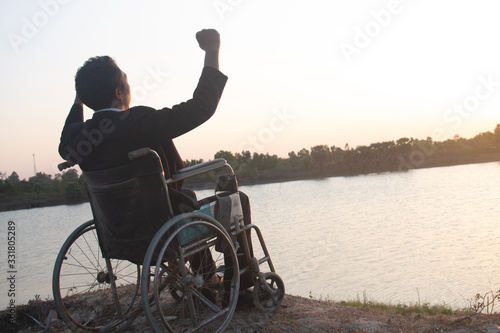 Vászonkép Young disabled man with river background