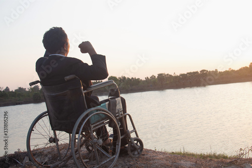 Young disabled man with river background Tapéta, Fotótapéta