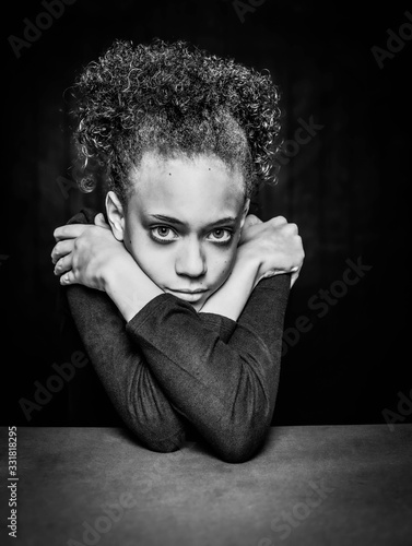 Black and White Vertical Shot of Pretty Young Girl with Arms Crossed Canvas Print