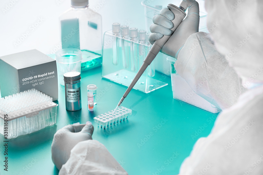 Fototapeta Novel coronavirus detection: pcr kit for detection of SARS-COV-2 novel coronavirus and rapid kit to detect antibodies for the virus in blood of recovered patients. Epidemiologist works in test lab.