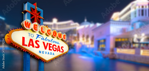 Photo Welcome to Never Sleep city Las Vegas, Nevada Sign with the heart of Las Vegas scene in blur background