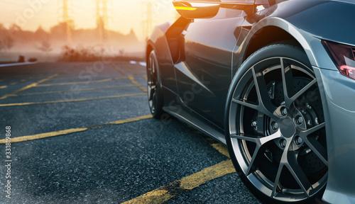 Obraz Black car on the road. - fototapety do salonu