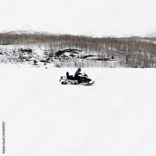 Snowmobiler driving in the backcountry Canvas Print