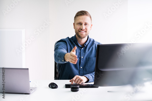 Photo Smiling Lawyer Offering Handshake At Desk