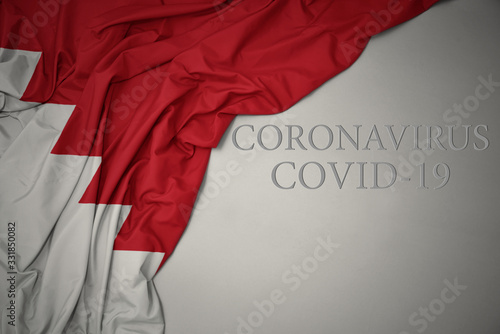 waving national flag of bahrain on a gray background with text coronavirus covid-19 Wallpaper Mural
