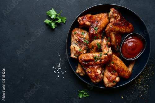 Fototapeta Grilled spicy chicken wings with ketchup. Top view with copy space. obraz