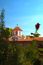 Greek Church Tower With Rose In Front In Bokeh - Vacation In Greece Concept