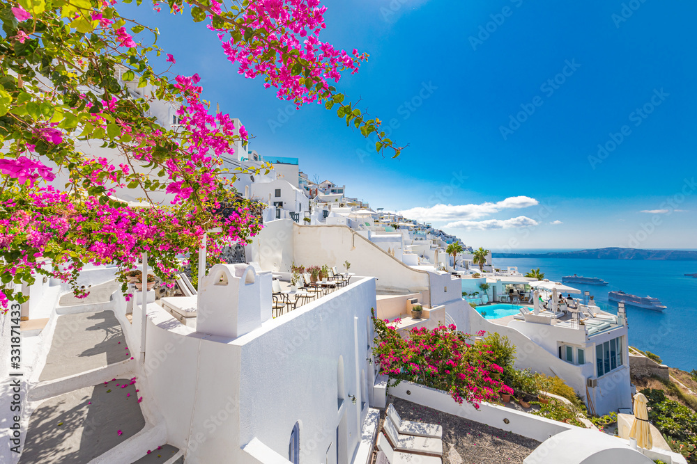 Amazing travel landscape in Santorini, Greece. White architecture with pink flowers under blue sky. Tranquil caldera view, summer landscape, peaceful scenery for summer vacation and holiday <span>plik: #331871433 | autor: icemanphotos</span>