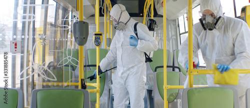 Fotomural HazMat team in protective suits decontaminating public transport, bus interior d