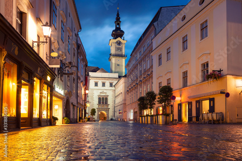 Linz, Austria. Cityscape image of old town Linz, Austria during twilight blue hour with reflection of the city lights.